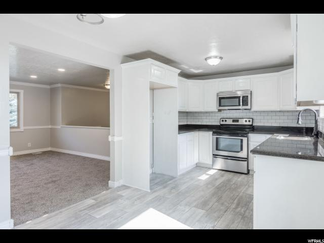 4523 S Woodgrove Dr W, West Valley City, UT 84120 (#1545595) :: Exit Realty Success