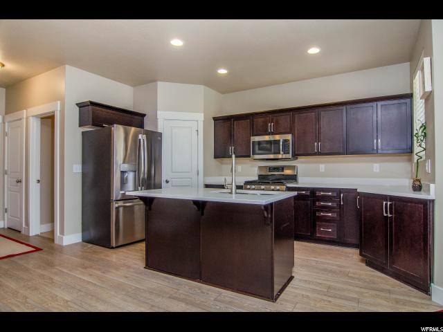401 E Frost Ln, Stansbury Park, UT 84074 (#1551299) :: Exit Realty Success