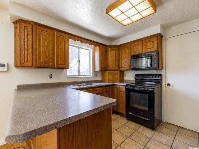 12015 S 2160 W, Riverton, UT 84065 (#1633713) :: Big Key Real Estate