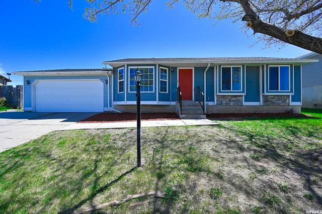 6135 W Powderwood Dr S, West Valley City, UT 84128 (#1670472) :: Colemere Realty Associates