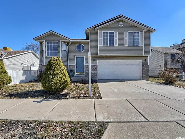 830 S Meadow View Dr W, Ogden, UT 84404 (#1657588) :: Colemere Realty Associates