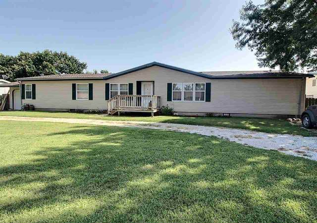 1120 E 10TH ST, Wellington, KS 67152 (MLS #585237) :: Kirk Short's Wichita Home Team