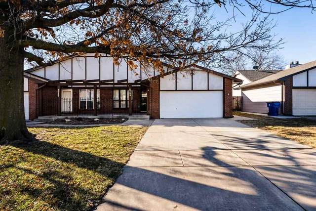 8709 E Lakeland Cir, Wichita, KS 67207 (MLS #592919) :: Graham Realtors
