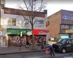83-12 Broadway - Photo 1