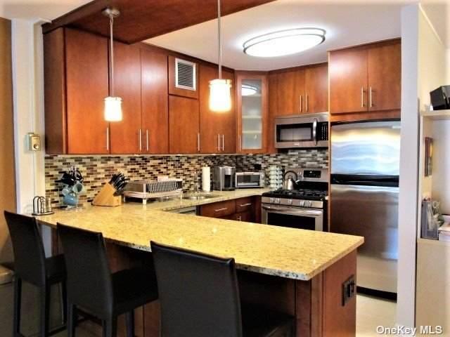 18-15 215th Street 12 K, Bayside, NY 11360 (MLS #3342475) :: Goldstar Premier Properties